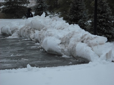 Yesterday, they plowed the parking lot before the ice came in.  This was the result.